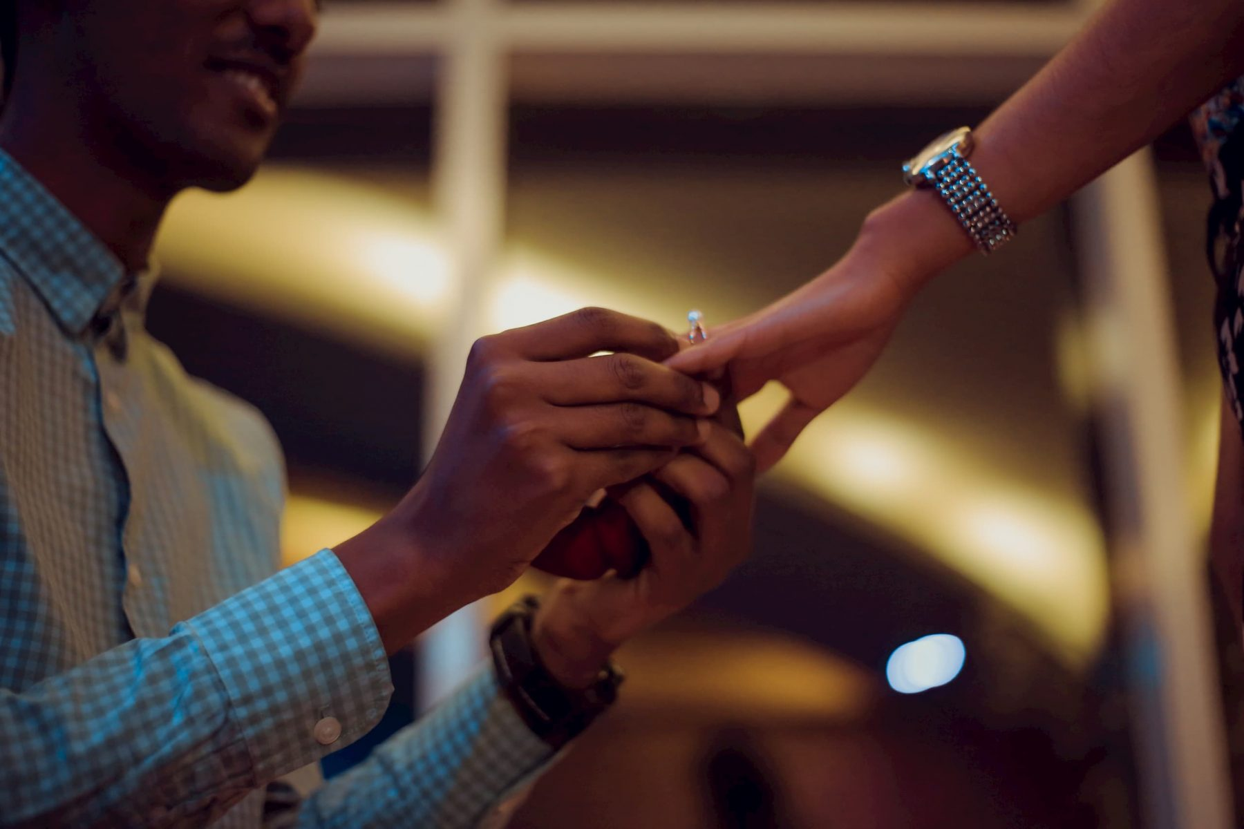 Man giving woman engagement ring